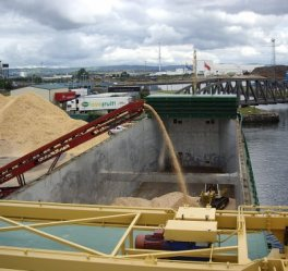 Wood chips being loaded on vessel
